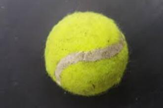 Het golfkarakter van tennisballen